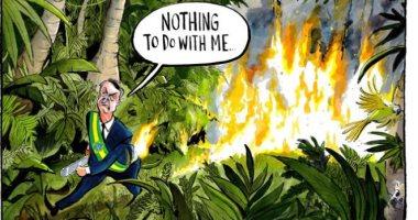 كاريكاتير التايمز يسلط الضوء على حرائق غابات الآمازون ويتهم بولسونارو