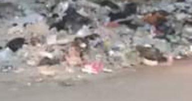 اضبط مخالفة.. أكوام القمامة تحاصر مدرسة الرافعى بشبرا الخيمة