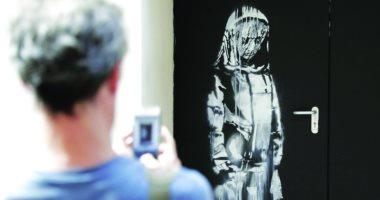 إيطاليا تعيد لـ فرنسا لوحة بانكسى المسروقة منذ عام رسمها لضحايا هجمات نوفمبر