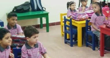 """أول يوم مدرسة .. محمد يشارك بصورة ابنه معاذ """"كجى 1"""" بأجمل يونيفورم"""