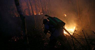 صور..رجال الإطفاء فى بوليفيا يفشلون فى السيطرة على حرائق الغابات مع اتساعها