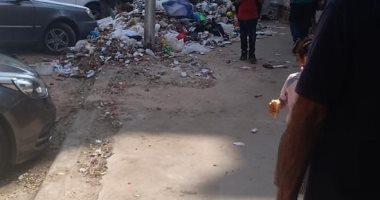 شكوى من تراكم القمامة فى شارع حلمية الزيتون