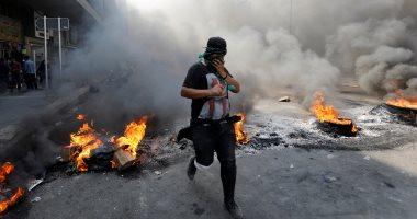 اشتباكات بين المتظاهرين و شرطة مكافحة الشغب فى بغداد