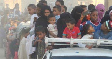 """صور.. المئات من أهالى قرى أسوان يشاركون فى احتفالات """"دورة المولد النبوى """""""