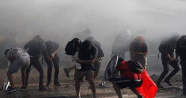 صور.. اشتباكات بين الشرطة ومتظاهرين يطالبون باستقالة الرئيس بينيرا فى تشيلى