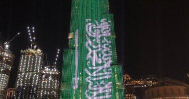 برج خليفة يتزين بألوان العلم السعودى احتفاءً بزيارة محمد بن سلمان للإمارات