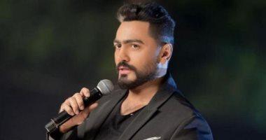 """خالد الصاوى يدعم تامر حسنى فى سباقه على """"جينيس ريكورد"""".. ونجم الجيل يرد"""