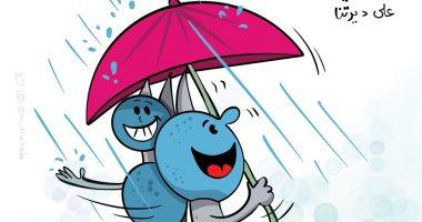 كاريكاتير صحيفة كويتية.. فرحة المواطنين بسقوط أمطار الخير