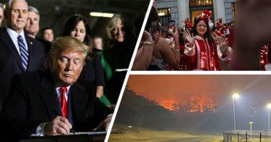 صور.. العالم هذا الصباح.. ترامب يوقع على الميزانية العسكرية لعام 2020 بقيمة 738 مليار دولار.. اشتداد حدة حرائق الغابات فى أستراليا ونزوح الحيوانات.. مسيرات بالملابس المضيئة فى شوارع البرازيل احتفالا بالكريسماس