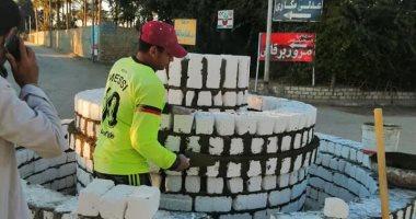 صور.. تجميل مداخل قرى منشأة القناطر والبدء فى رصف 5 طرق بالعياط