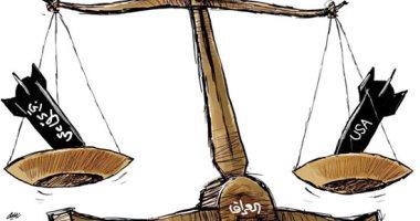 كاريكاتير صحيفة سعودية.. العراق ساحة للقتال بين أمريكا وإيران