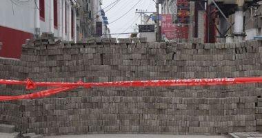 صور.. جدران من الطوب حول قرى فى الصين ونقاط تفتيش بسبب كورونا