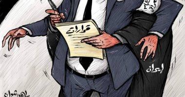 كاريكاتير صحيفة إماراتية.. النظام الإيراني يدخل بشكل سافر فى الشأن العراقى