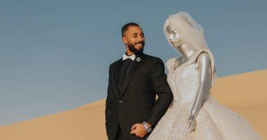 العريس سنجل والعروسة مانيكان.. اعرف حكاية فوتوسيشن الزفاف المثيرة للجدل..فيديو