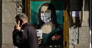 رعب كورونا يصل للموناليزا.. اللوحة الشهيرة ترتدى قناعا للوجه.. أعرف القصة