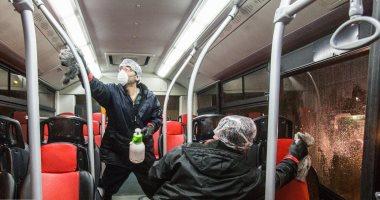 """إيران """"تعقم"""" المواصلات العامة بعد وفاة 5 بسبب كورونا واصابة 28.. صور"""