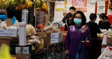 مواطنو الحى الصينى فى أمريكا بأقنعة الوجه خوفا من كورونا