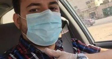 """بالجوانتى والكمامة.. علاء يشارك فى مبادرة """"اليوم السابع"""" للوقاية من كورونا"""