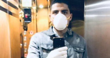 """""""محمد"""" يشارك صورة له بالجوانتى والكمامة من الفيوم للوقاية من فيروس كورورنا"""