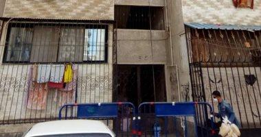 صور.. عزل عمارتين بحى الضواحى فى بورسعيد بعد اكتشاف حالتى كورونا