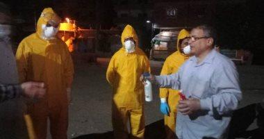 صور.. دفن جثمان أحد مصابي كورونا بمسقط رأسه بقرية الهياتم