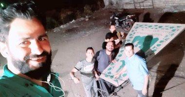 شاب قبطى بقرية الحتاحته بالمنيا يهدى مسلمى قريته فانوسا عملاقا احتفالا برمضان