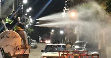 بالتزامن مع ساعات الحظر.. رش وتعقيم شوارع الغربية ..صور