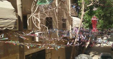 أهالى شارع الشيمى بالطالبية فى الجيزة يزينون الطرق احتفالا ببهجة رمضان