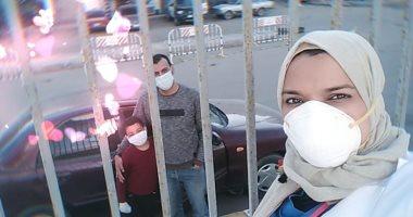 """مدير العزل الطبى بالعجمى: """"زوجى وأطفالى يزورونى من وراء قضبان المستشفى"""""""