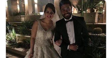 """محمد عز يكشف لـ""""اليوم السابع"""" حقيقة تداول صورته مع منى فارق بفستان الزفاف"""