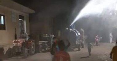 شباب قرية ابتوك بالبحيرة يطهرون شوارع القرية ويوزعون كرتونة مساعدات