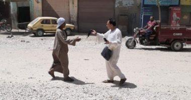 """توزيع الكمامات مجاناً على سكان المناطق المعزولة بسبب """"كورونا"""" بالفيوم"""