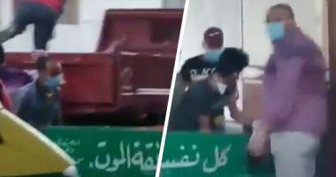 نقل جثمان متوفى بكورونا بسيارة نقل دون إجراءات وقائية فى قنا.. فيديو