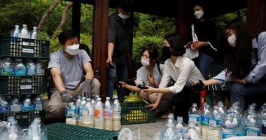 """""""المنشقين الكوريين"""" يهربون الكمامات والأرز فى زجاجات لكوريا الشمالية"""