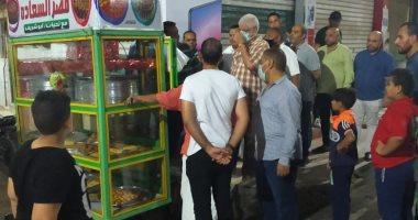 رفع إشغالات متنوعة من أمام المحلات في حملة مسائية  ببني سويف