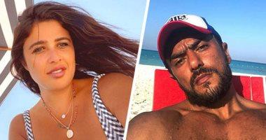 العوضي وياسمين عبدالعزيز يستمتعان بالإجازة الصيفية على أحد الشواطئ