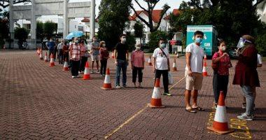 بالكمامات وقواعد التباعد الاجتماعى.. انطلاق الانتخابات العامة فى سنغافورة