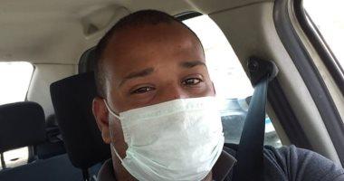 """""""يحيى"""" محاسب قانونى يشارك صورته بالكمامة خلال ذهابه لعمله بمحافظة الجيزة"""