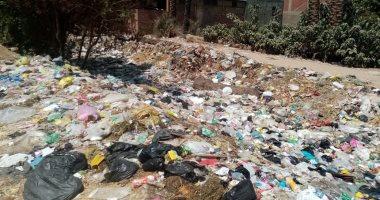 تراكم القمامة فى الترعة الخواجاية فى منطقة كفر غطاطى بمحافظة الجيزة