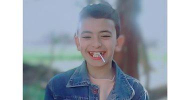 """حكاية صورة.. """"محمود"""" يحكى قصة صورته بعد خلع نصف أسنانه فى عمر الـ9 سنوات"""
