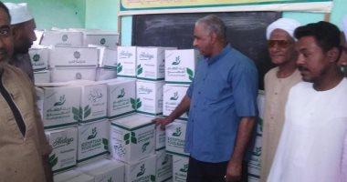 صور... تضامن إسنا توزع 197 كرتونة مواد غذائية للمسنين