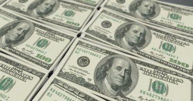 ضبط تاجر عملة بالسوق السوداء بحوزته 21 ألف دولار