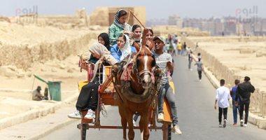 إقبال المصريين على الأهرامات رغم كورونا والطقس الحار