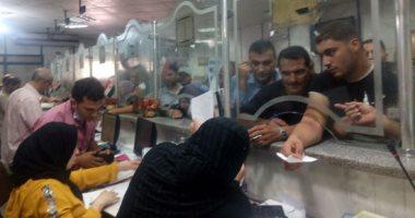 ماذا فعلت محافظة الجيزة لحل التزاحم على تقديم طلبات التصالح أمام الأحياء؟