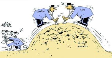 تدخلات الدول العظمى تشعل الصراعات بالشرق الأوسط فى كاريكاتير صحيفة عمانية