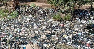 شكوى من تراكم القمامة فى ترعة باسوس بالقليوبية ومطالب بتغطيتها
