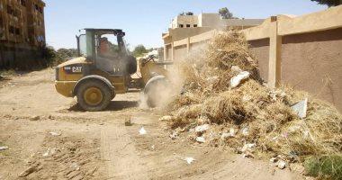 محافظة الجيزة ترفع 20 طن مخلفات وتنفذ حملة لصيانة أعمدة الإنارة بالواحات