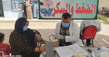 توقيع الكشف الطبى على 1231 عبر القافلة الطبية العلاجية بقرية الظواهرية.. صور