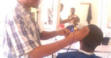 الشرطة السودانية تنفذ حملات حلاقة إجبارية للشباب أصحاب الشعر الطويل - اليوم السابع