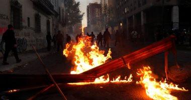 صور.. مظاهرات تشيلى تتحول إلى حرب شوارع مع الشرطة